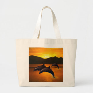 Three dolphins at sunset large tote bag