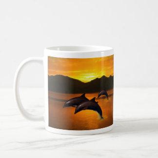 Three dolphins at sunset coffee mug