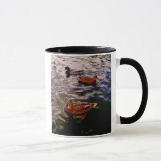 Three ducks in a pond mug