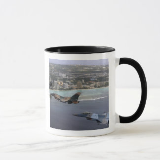 Three F-16 Fighting Falcons fly in formation Mug