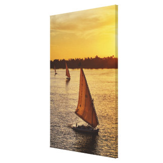Three falukas with sightseers on Nile River at Canvas Print