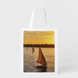 Three falukas with sightseers on Nile River at Market Tote