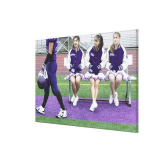 Three female cheerleaders (16-18) watching canvas print