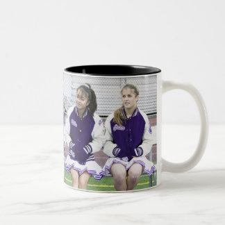 Three female cheerleaders (16-18) watching Two-Tone coffee mug