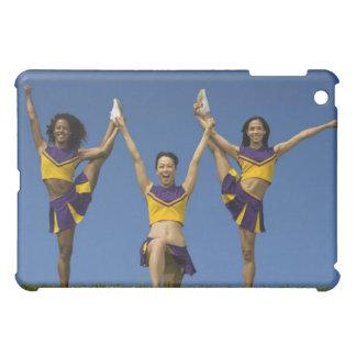Three female cheerleaders doing formation iPad mini cases