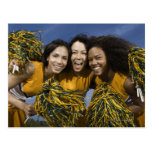 Three female cheerleaders holding pompoms postcard