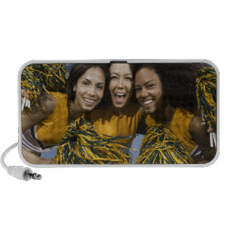 Three female cheerleaders holding pompoms notebook speakers