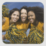 Three female cheerleaders holding pompoms square stickers