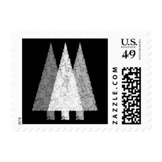 Three Festive Trees. White on Black. Postage Stamp