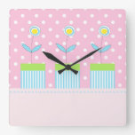 Three flowers on pink with white dots square clock