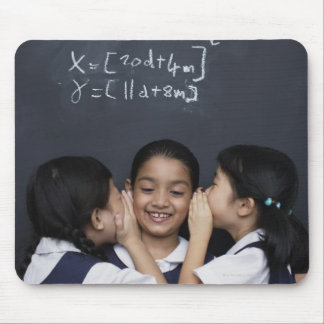 Three girls in classroom whispering mouse pad
