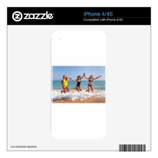 Three girls jumping on beach near sea.JPG Skins For iPhone 4