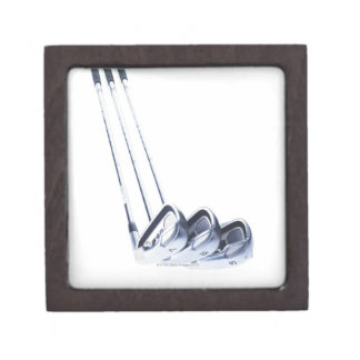 Three golf clubs on white background jewelry box
