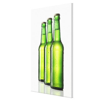 Three green bottles of beer on white background, canvas print