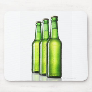 Three green bottles of beer on white background, mouse pad