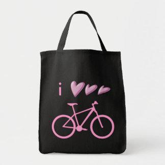 Three hearts and a pink mountain bike bag. tote bag