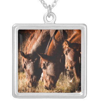 Three horses drinking in dusky light silver plated necklace