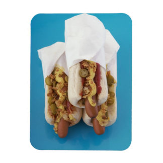Three hot dogs in buns rectangular photo magnet
