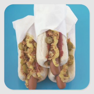 Three hot dogs in buns square sticker