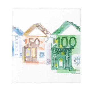 Three houses made of bank notes notepad
