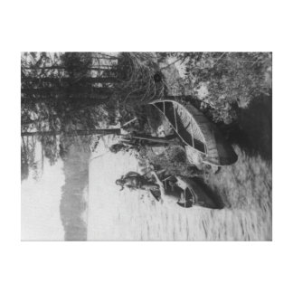 Three Hunters with Canoes at Shore Photograph Canvas Prints