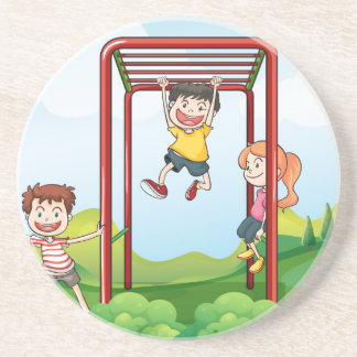 Three kids playing at the park beverage coaster