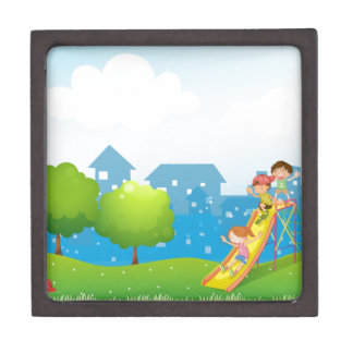 Three kids playing at the playground premium keepsake box