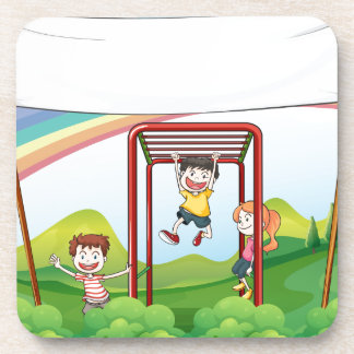 Three kids playing near the empty banner beverage coaster