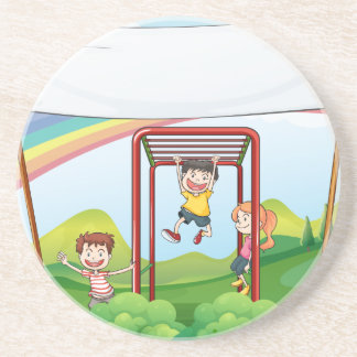 Three kids playing near the empty banner drink coaster