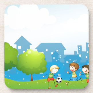 Three kids playing soccer in the hill coasters