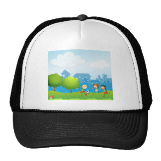 Three kids playing soccer in the hill trucker hat