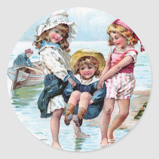 Three Little Girls Playing at the Beach Classic Round Sticker