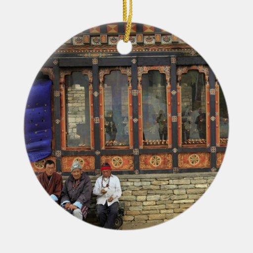 Three men sit on a bench at the Memorial Chorten Double-Sided Ceramic Round Christmas Ornament
