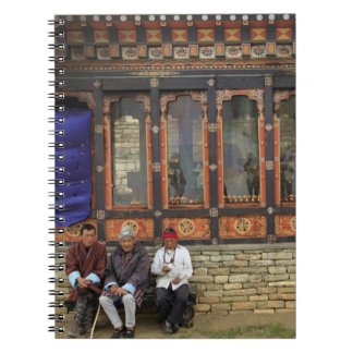 Three men sit on a bench at the Memorial Chorten Notebook