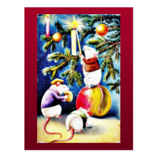 Three mice playing with gifts in the christmas tre postcard