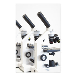 Three microscopes in a row isolated on background stationery