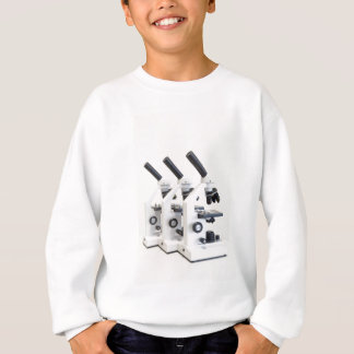 Three microscopes in a row isolated on background sweatshirt