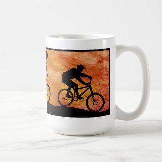 Three Mountain Bikers at Dawn Coffee Mug