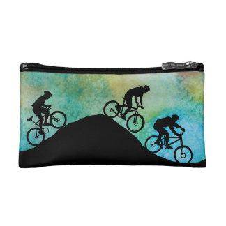 Three Mountain Bikers at Dusk Cosmetics Bags