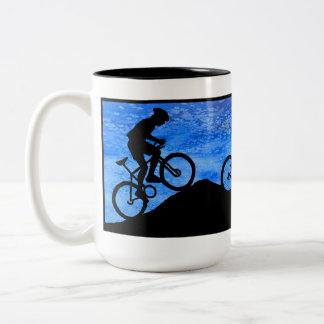 Three Mountain Bikers at Dusk Mug