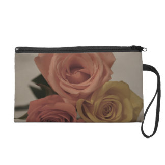 three pale roses Colored in vintage shades Wristlet