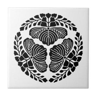 Three paulownia blooms, heads facing outward ceramic tile