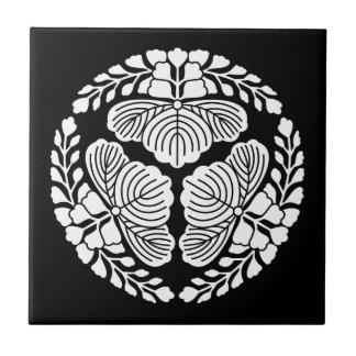 Three paulownia blooms, heads facing outward tile