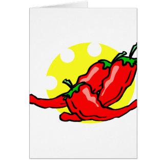 Three peppers lying in eaten sun card