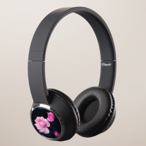 Three Pink Roses on a dark background. Headphones