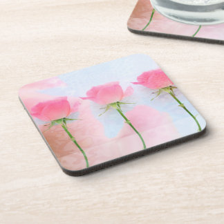 Three pink roses on blue drink coaster