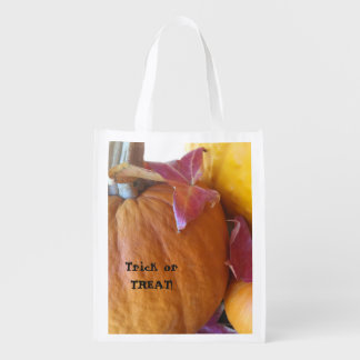 Three pumpkins with leaves trick or treat grocery bag