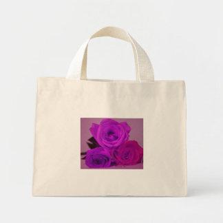 Three roses, tinted purple on a purple back canvas bag