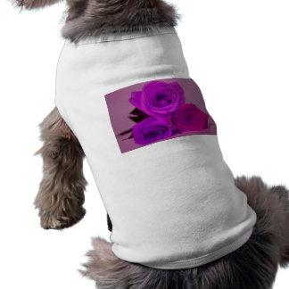 Three roses, tinted purple on a purple back dog tshirt