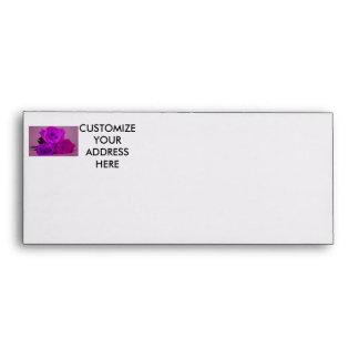 Three roses, tinted purple on a purple back envelopes